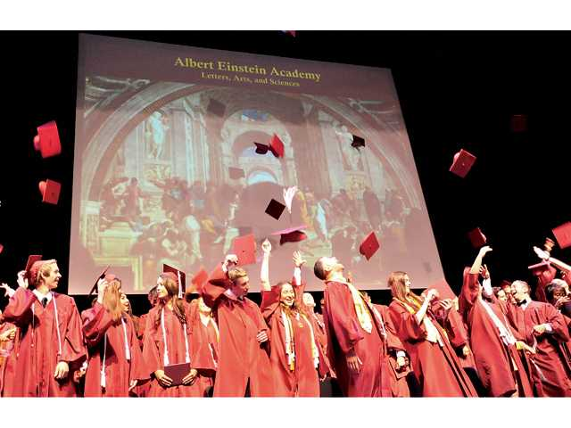 The inaugural graduates of the Albert Einstein Academy celebrate receiving their diplomas at the College of the Canyons Performing Arts Center on Thursday in Valencia. Signal photo by Katharine Lotze.