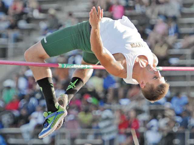 Canyon High's Brett Molster clears 6 feet, 5 inches during the high jump competition on Friday at Cerritos College during the CIF-Southern Section Masters Meet.