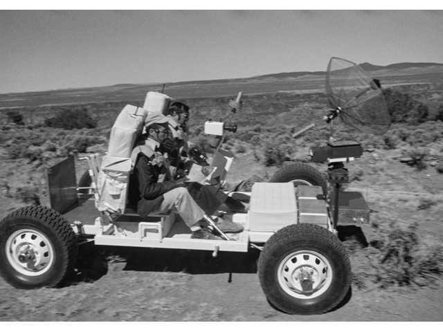 "This 1971 image provided by NASA shows Apollo 17 astronauts, Harrison ""Jack"" Schmitt, left, and an unidentified man, training with the lunar roving vehicle on the Big Island of Hawaii."
