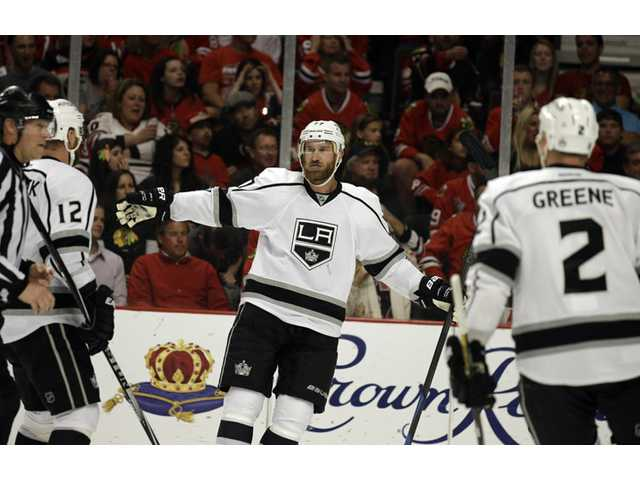 Los Angeles Kings center Jeff Carter celebrates after scoring a goal against Chicago Blackhawks in Game 7 of the Western Conference finals on Sunday in Chicago.