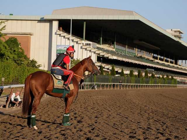 California Chrome's feel-good run at the Triple Crown is a too-good-to-be-true story that has virtually no chance of repeating itself. Above, the horse and joceky enter Belmont Park on Monday.