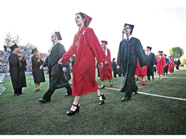 Hart High School graduating seniors march onto the College of the Canyons football field in Valencia during their graduation ceremony Tuesday. Signal photo by Dan Watson.