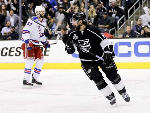 Los Angeles Kings right wing Justin Williams, right, celebrates his game winning goal as New York Rangers left wing Benoit Pouliot looks on in overtime of Wednesday's Game 1 in Los Angeles.
