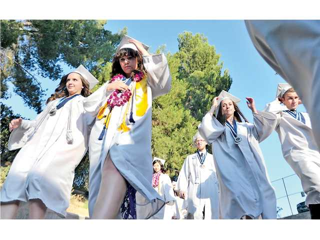 Some of the 515 Saugus High School graduates enter Cougar Stadium at College of the Canyons on Wednesday. Signal photo by Katharine Lotze.