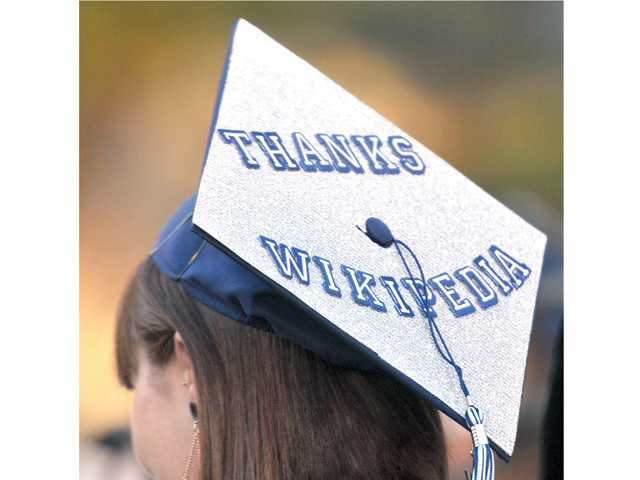 A Saugus High School grad's cap provides an ode to the online encyclopedia Wikipedia during Wednesday's ceremony. Signal photo by Katharine Lotze.