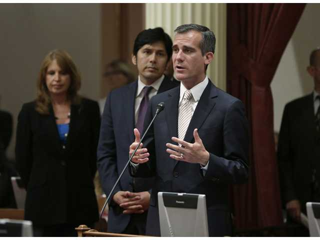 Los Angeles Mayor Eric Garcetti, right, addresses the state Senate during his first official visit to the Capitol in Sacramento,Calif., June 5.