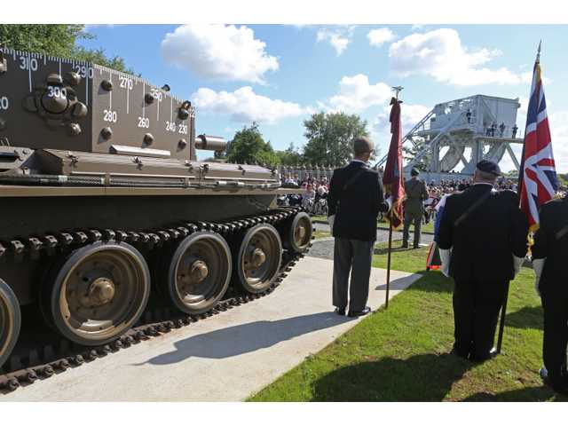 A remembrance ceremony is held at Pegasus Bridge memorial in Benouville western France, Thursday June 5, 2014.