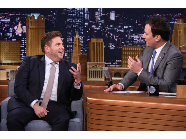 "This June 3, 2014 photo released by NBC shows actor Jonah Hill, left, with host Jimmy Fallon during a taping of ""The Tonight Show with Jimmy Fallon,"" in New York."