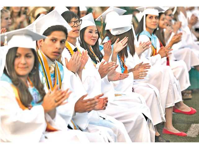 Canyon High School honors graduates clap for parents and grandparents at their commencement ceremonies at College of the Canyons on Thursday.Signal photo by Katharine Lotze.