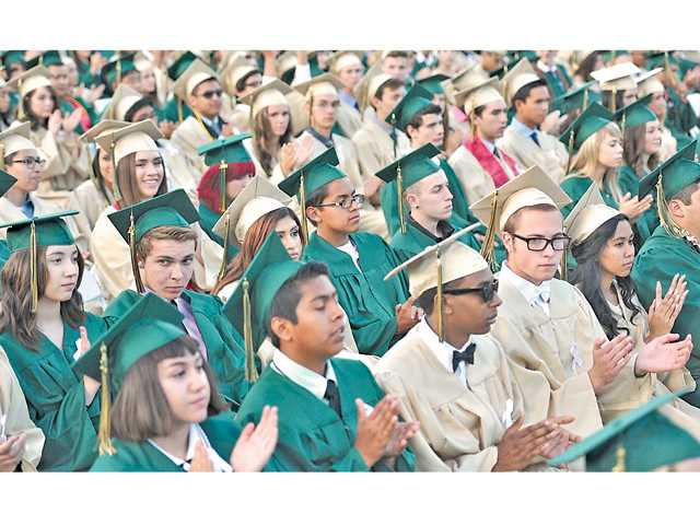Canyon High School graduates clap for faculty and staff at their commencement ceremonies at College of the Canyons on Thursday.Signal photo by Katharine Lotze.