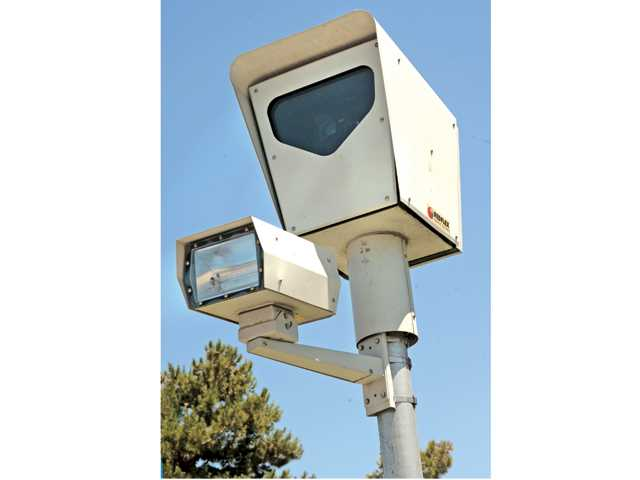 Red Light camera at the intersection of McBean Parkway and Magic Mountain Parkway. Signal file photo