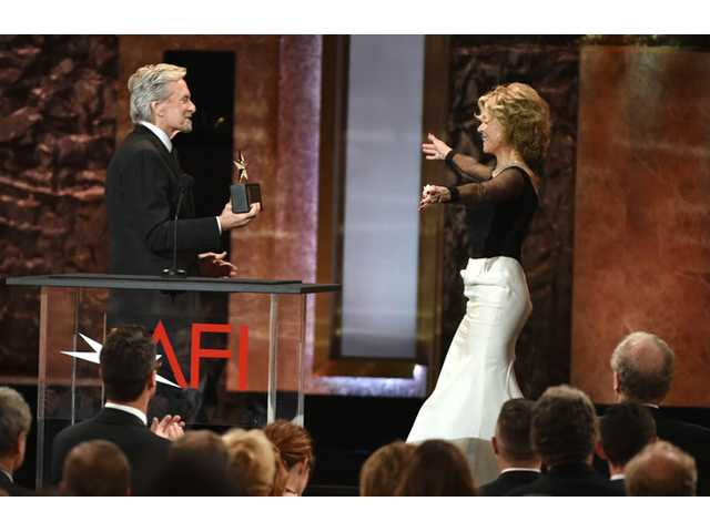 Michael Douglas, left, presents the AFI Lifetime Achievement Award to Jane Fonda at the 42nd AFI Lifetime Achievement Award Tribute Gala.