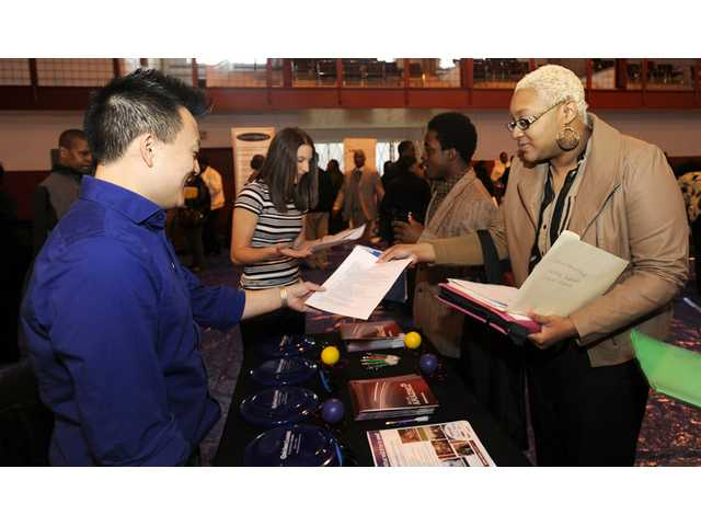 US employers add 217K jobs; rate stays at 6.3 pct.