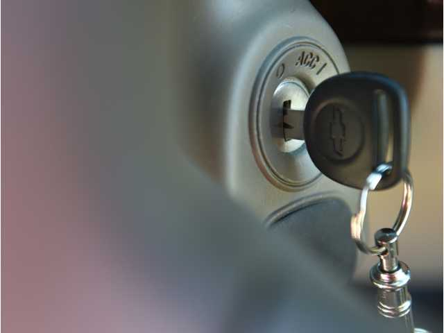 This April 1, 2014 file photo shows the ignition switch of a 2005 Chevrolet Cobalt in Alexandria, Va.