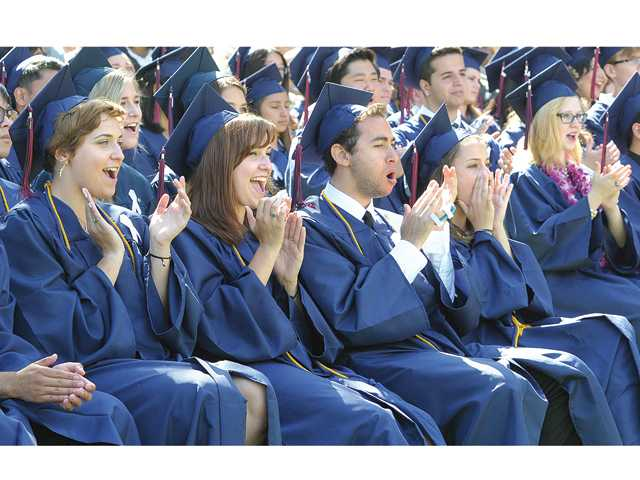 Members of Academy of the Canyons 2014 graduating class applaud the speeches on stage at the commencement ceremony held at College of the Canyons in Valencia on Saturday morning.