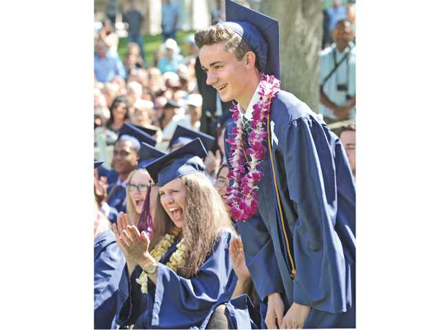 Members of Academy of the Canyons 2014 graduating class applaud their classmate, Samuel Lindberg, right, as he is named to receive the Principal's Award at the commencement ceremony held at College of the Canyons in Valencia on Saturday morning.