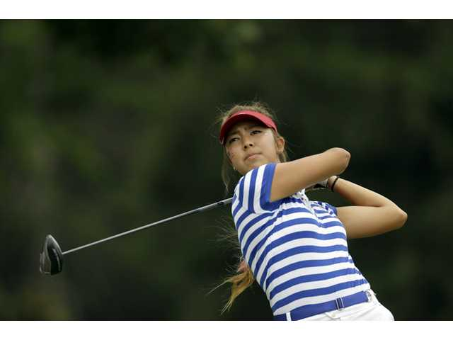 United States golfer and Valencia graduate Alison Lee tees off on the fourth hole during the final day of the 38th Curtis Cup on Sunday in St. Louis.