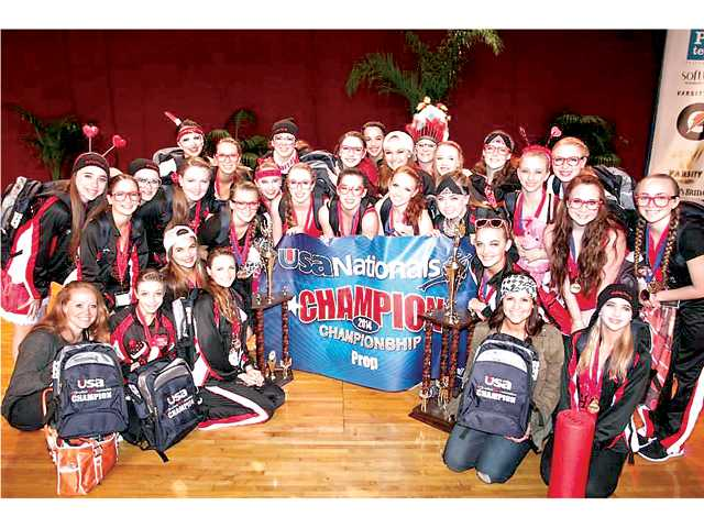 The Hart Dance Team surrounds their trophies after they won the Prop category at the USA Nationals
