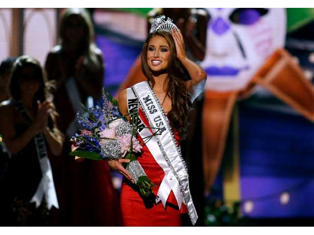 Miss Nevada USA Nia Sanchez adjusts her crown after being names Miss USA during the Miss USA 2014 pageant in Baton Rouge, La. on Sunday.