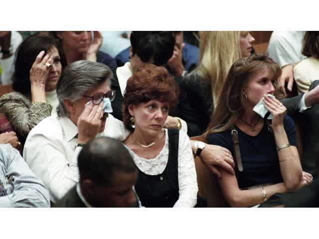 In this Sept. 26, 1995 file photo, Ron Goldman's father Fred Goldman wipes a tear during the prosecution's closing arguments in the O.J. Simpson double-murder trial