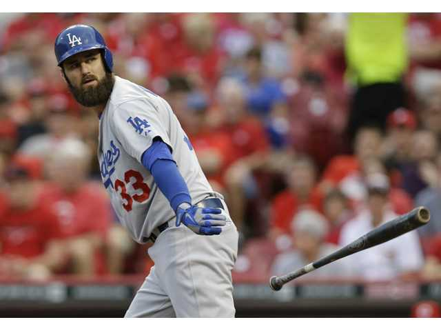 Los Angeles Dodgers left fielder Scott Van Slyke walks against the Cincinnati Reds on Monday in Cincinnati.