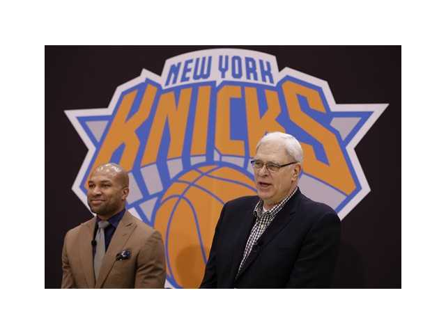 While Derek Fisher, left, listens, New York Knicks president Phil Jackson speaks during a news conference in Tarrytown, N.Y., Tuesday, June 10, 2014. The Knicks hired Fisher as their new coach on Tuesday, with Jackson turning to one of his trustiest former players. (AP Photo/Seth Wenig)