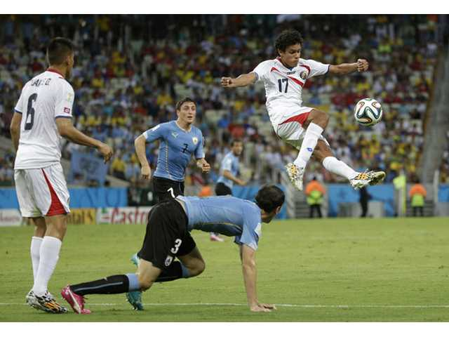 Costa Rica's Yeltsin Tejeda clears the ball during the group D World Cup soccer match between Uruguay and Costa Rica at the Arena Castelao in Fortaleza, Brazil, Saturday, June 14, 2014.