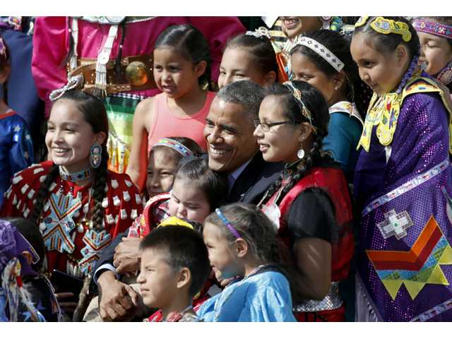 President Barack Obama poses with Native America dancers during his visit to the Standing Rock Indian Reservation on Friday in Cannon Ball, N.D.