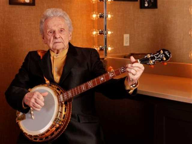 In this March 11, 2011 file photo Ralph Stanley poses for a photo backstage at the Grand Ole Opry House in Nashville, Tenn.