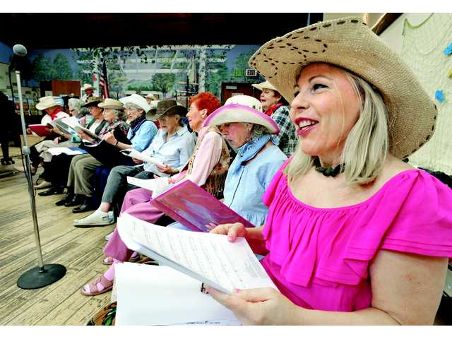"Leslie Shapouri, right, joins the Bluebells as they sing ""Blue Bayou"" at the Country Western Hoedown presented by The SCV Senior Center Silverstones & Memory Makers at the SCV Senior Center in Newhall on Thursday."