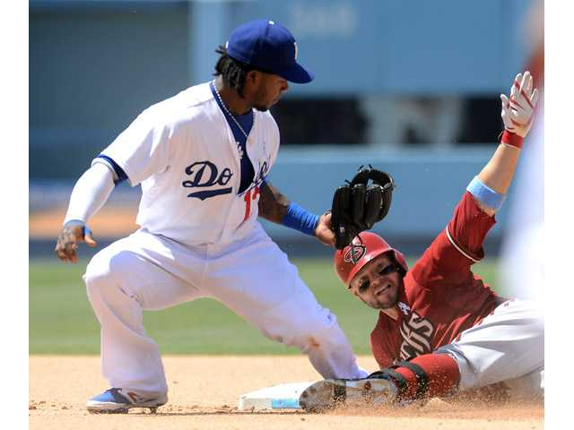 Los Angeles Dodgers shortstop Hanley Ramirez, left, makes the tag on Arizona Diamondback Cody Ross on Sunday in Los Angeles.