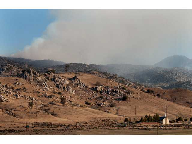 The Shirley Fire continues to burn Sunday near viewed from Highway 178 in Lake Isabella, Calif.