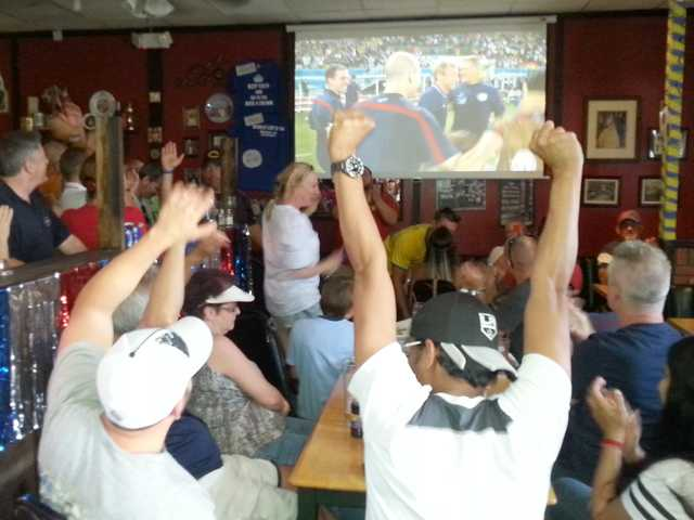 Soccer fans celebrate Team USA's World Cup win over Ghana at the Rose and Crown British Restaurant in Newhall on Monday. Signal photo by Mason Nesbitt