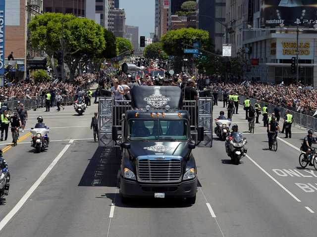 One of the vehicles carrying the of the Stanley Cup trophy moves along a parade route in Los Angeles.