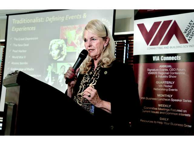 Dianne Van Hook, chancellor of College of the Canyons describes generational influences as she speaks at the VIA luncheon held at Valencia Country Club on Tuesday.