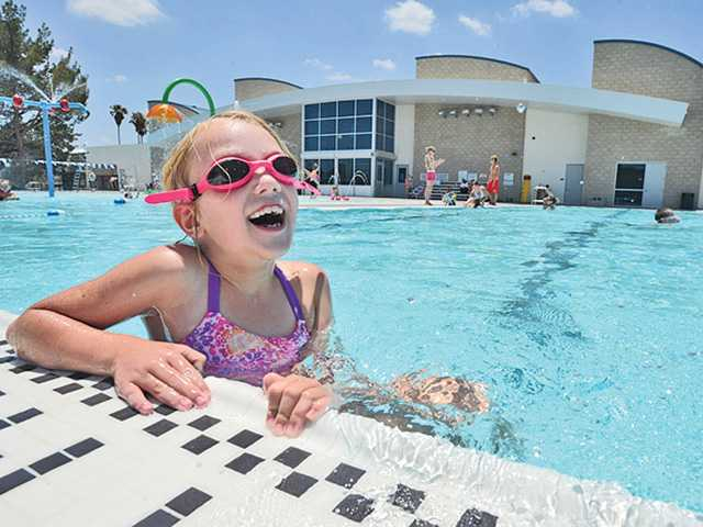 Lexie Smith, 7, of Frazier Park splashes during recreation swim time at the Castaic Aquatic Center on Tuesday. Recreation swim for all ages runs from 12:30 p.m. to 5 p.m. daily at the center. Signal photo by Dan Watson