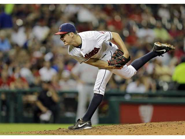 Cleveland Indians pitcher and Hart High graduate Trevor Bauer pitches against the Los Angeles Angels on Monday in Cleveland.
