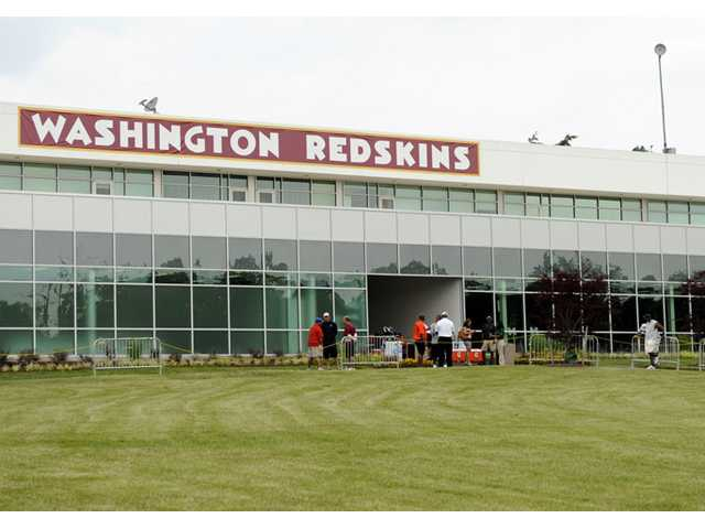 The Washington Redskins name is displayed on a building at their training facility at Redskins Park during NFL football minicamp