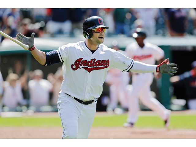 Cleveland Indians' Nick Swisher celebrates his walkoff grand slam against the Angels on Thursday in Cleveland.