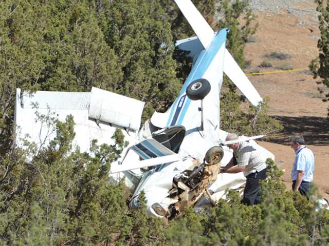 Investigators examine a light plane that crashed in Agua Dulce on Friday. Two people were seriously injured and taken to Henry Mayo Newhall Hospital. Signal photo by Dan Watson