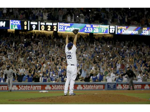 Dodgers starting pitcher Clayton Kershaw celebrates his no-hitter against the Colorado Rockies after the last out of Wednesday's in Los Angeles.