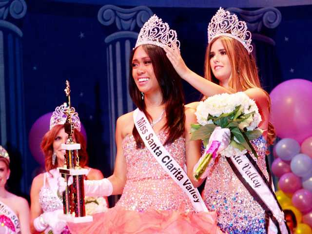 Genevieve Caleja, center, the 35th Miss Santa Clarita Valley is crowned by 2013 Miss Santa Clarita Valley Kelsie Leach, right.