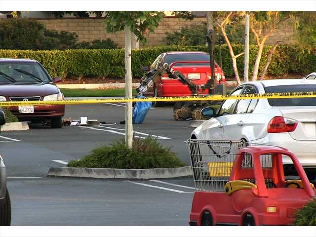 ASheriff's Arson/Explosives robot investigates a blue bag pulled from a car in the in theparking lot area of Whole Foods Market and Kohl's in Valencia Monday evening. Signal photo by Ryan Fonseca.