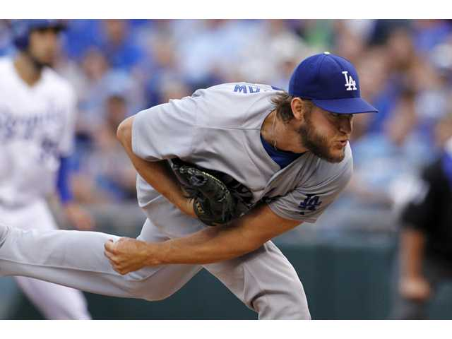 Los Angeles Dodgers pitcher Clayton Kershaw throws against the Kansas City Royals at Kauffman Stadium in Kansas City on Tuesday.