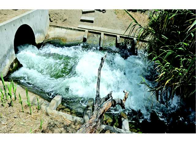 Treated wastewater discharged from the Sanitation District's Valencia Reclamation Plant flows toward the Santa Clara River. The Santa Clarita Valley's two water treatment plants were built before chloride limits were set and thus do not reduce chloride in SCV wastewater. Signal file hoto by Dan Watson