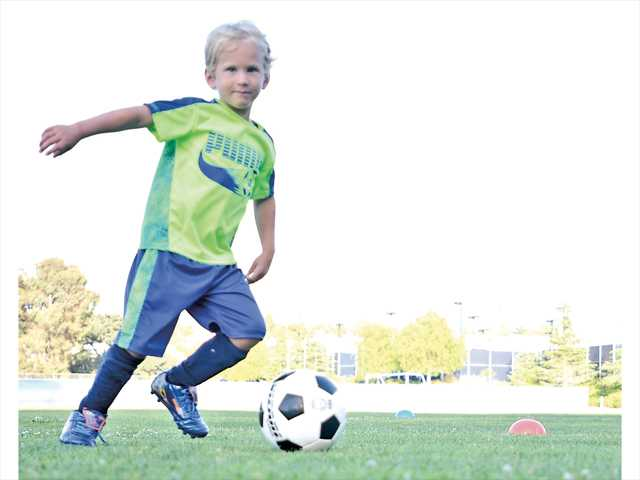 Zane Solomon, 4, goes for a goal at the Futbol Club Valencia Training Academy at College of the Canyons on Tuesday. The eight-week soccer camp is for boys and girls ages 4-9 and runs on Tuesdays and Thursdays through July 10.  Signal photo by Katharine Lotze.