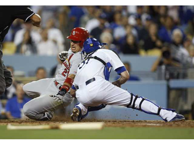 Los Angeles Dodgers catcher Drew Butera tags out St. Louis Cardinals' Jon Jay at home plate on a play that was reviewed during the seventh inning Thursday in Los Angeles.