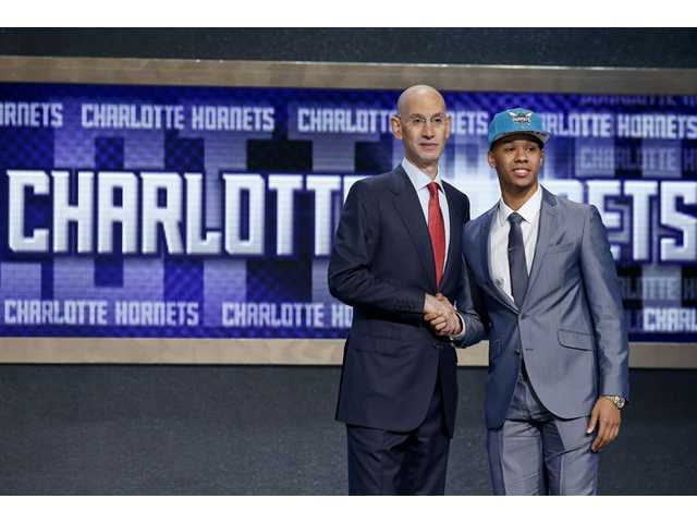 Connecticut's Shabazz Napier, right, poses for photos with NBA commissioner Adam Silver after being selected as the 24th overall pick by the Charlotte Hornets during the 2014 NBA draft on Thursday in New York.
