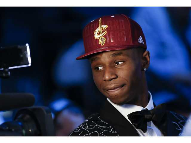 Andrew Wiggins of Kansas stops for a television interview after being selected by the Cleveland Cavaliers as the No. 1 pick in the 2014 NBA draft on Thursday in New York.