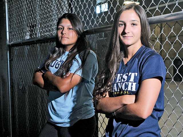 Saugus' Mariah Lopez, left, dominated league competition from the circle with 170 strikeouts and West Ranch's Lauren Lindvall led the Wildcats with a .500 batting average, 45 RBIs and 10 home runs.